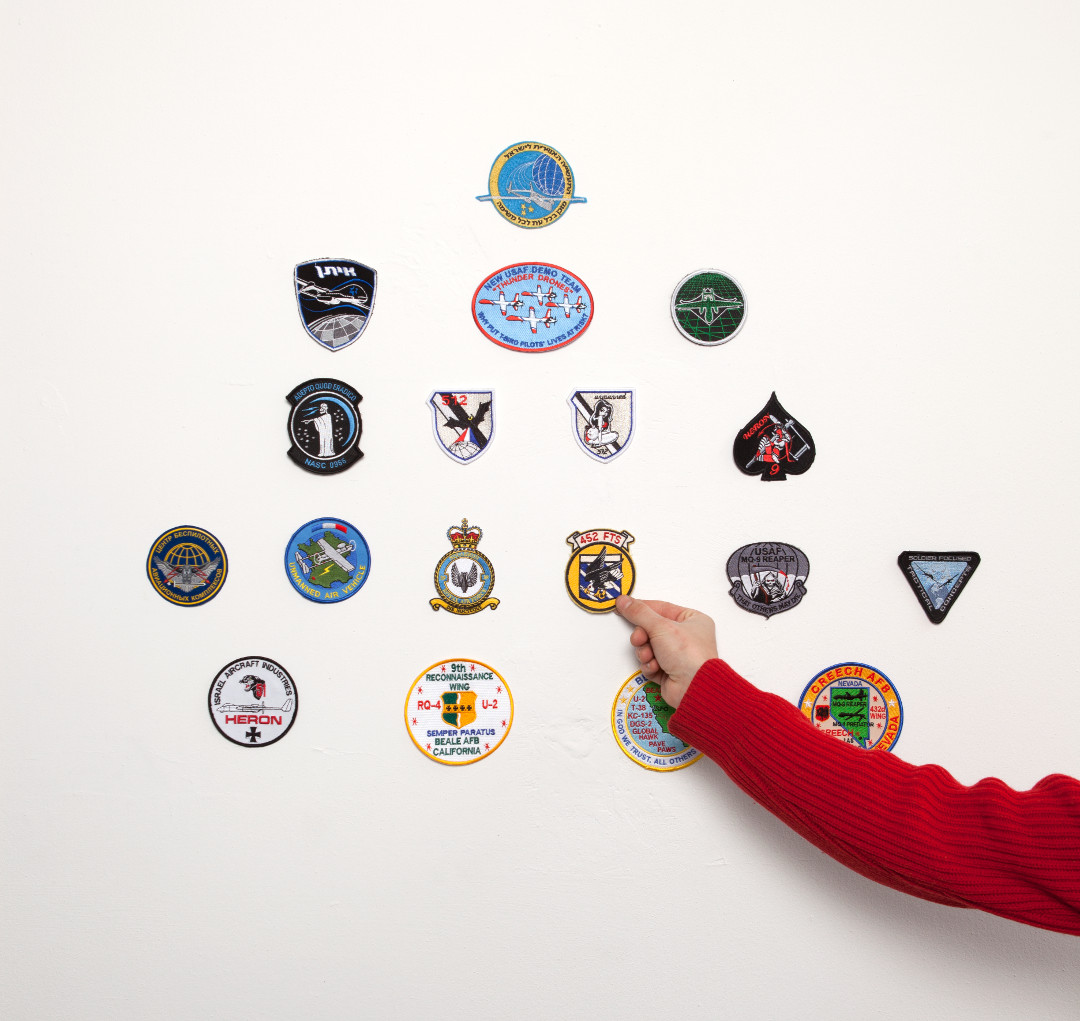 A collection of uniform patches worn by military units operating drones. The patches have been purchased on-line.